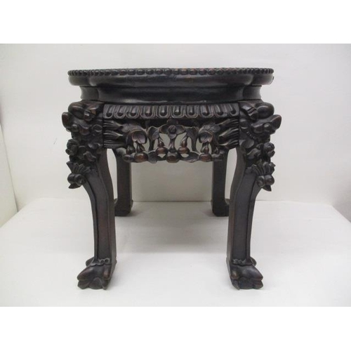 16 - A late 19th century rosewood stand with a serpentine outline, a mottled marble top and a flower and ...