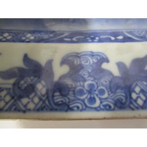 17 - A late 18th century Chinese blue and white rectangular meat plate with canted corners, decorated wit...