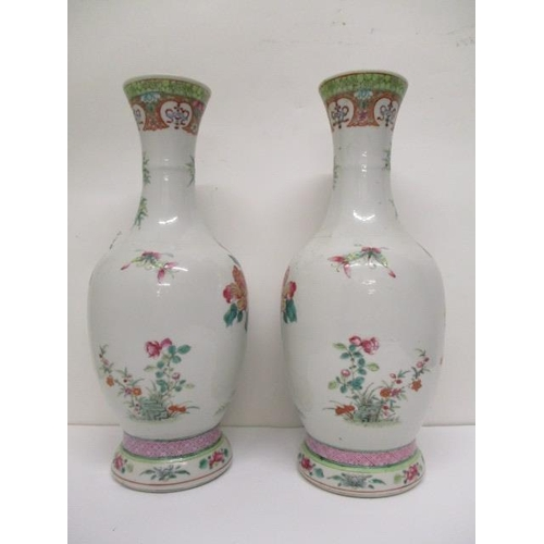 20 - A pair of late 19th century Chinese famille verte ovoid vases, with flared necks, decorated with bam...