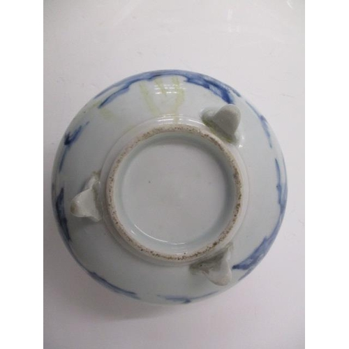 21 - A 19th century Japanese blue and white incense burner with a broad rim decorated with an island in a...