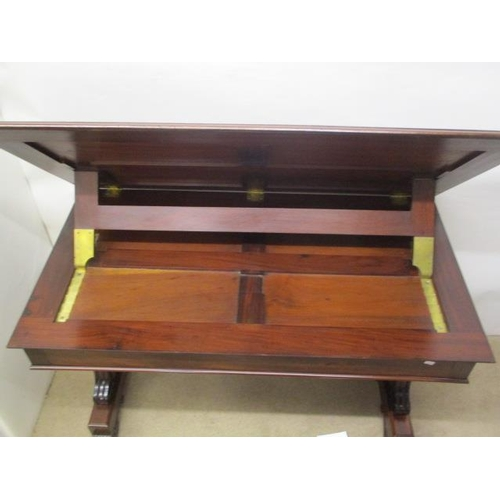 69 - A William IV mahogany library table with a ratchet, hinged, tooled leather top, over a frieze drawer...