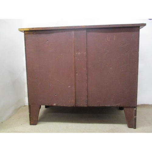 90 - A George III mahogany serpentine fronted dressing chest, the top having a satinwood and string inlai...