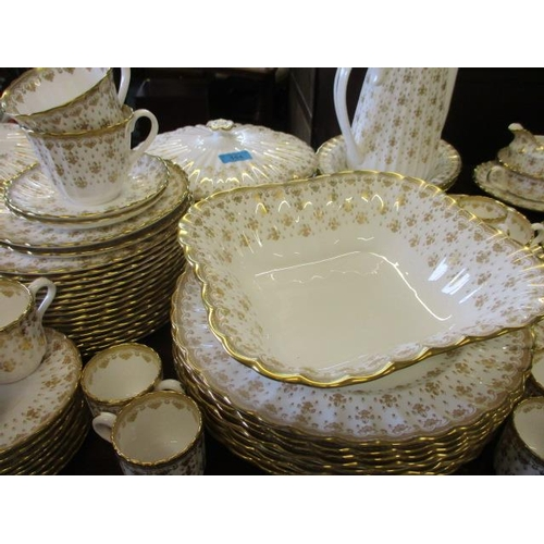 194 - An extensive Spode gold coloured Fleur de Lys part dinner and coffee service, white background with ...