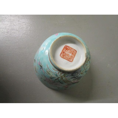 26 - A Chinese porcelain twin handled chocolate cup, decorated with medallion flower  heads in polychrome...