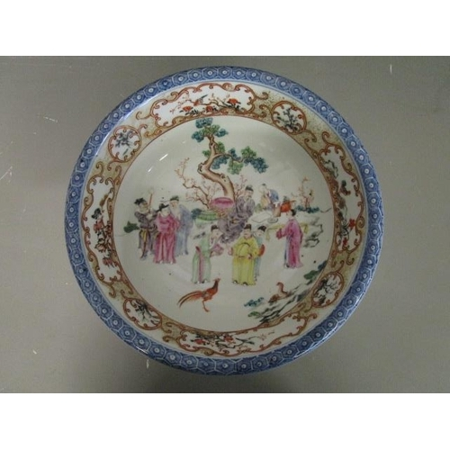 32 - An 18th century famille rose porcelain bowl with an everted rim and blue and white hexagonal pattern...