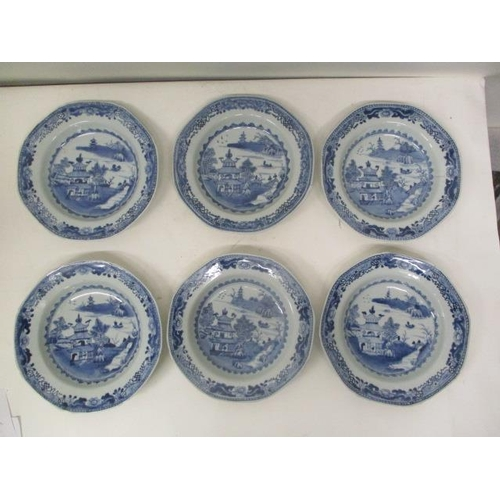 19 - A set of six late 18th century Chinese octagonal shaped plates, each decorated with a pagoda in a ri...