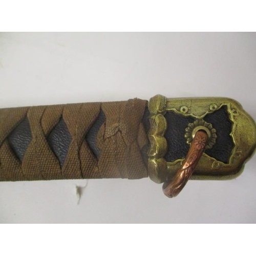 37 - A Japanese sword with a black leather and web bound handle with a brass Kashira, a copper ring, bras...