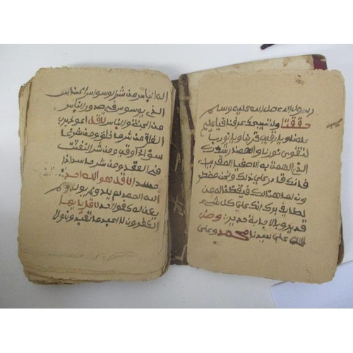 40 - A 19th century Islamic hand written book with card boards and leather spine contained in a stitched,...