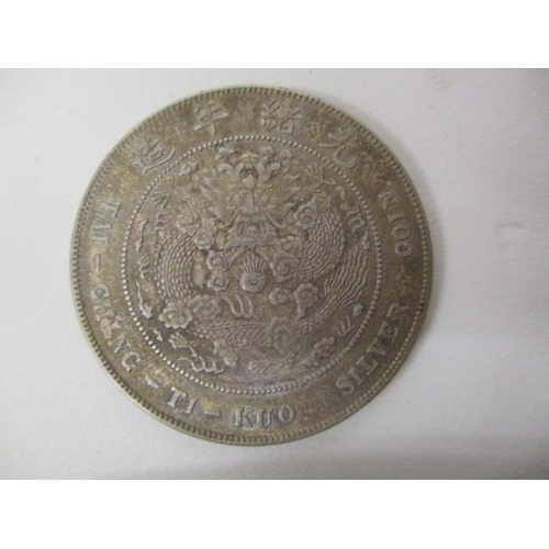 41 - A Chinese silver coloured coin, one side inscribed 34th Year of Kuang HSU Pei Yang and a dragon with...