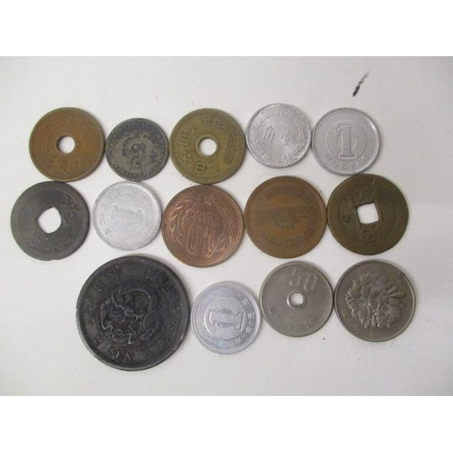 47 - Chinese and Japanese silver, copper and other coins to include a 2-Sen with a dragon to the centre a...