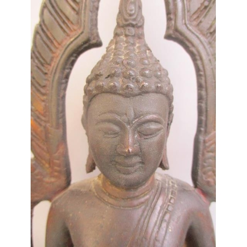 38 - A late 19th/early 20th century Indian cast bronze Buddha sitting under an arbour, on a plinth with p...