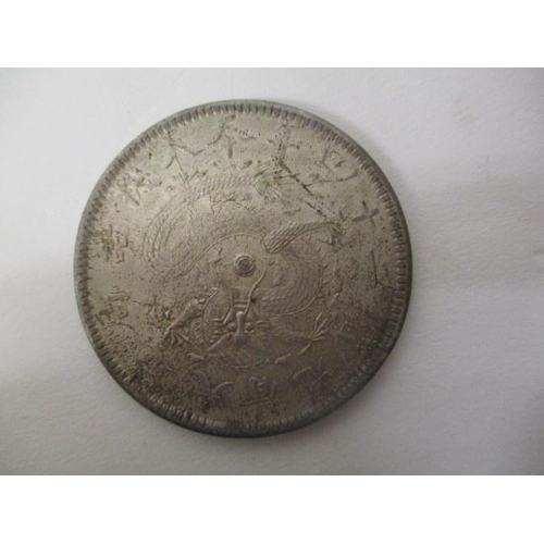 42 - A Chinese silver coloured coin, one side inscribed Fung Tien Province with a dragon and text to the ...
