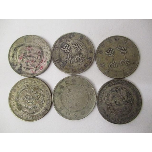 46 - Six Chinese silver coloured 1 Mace coins...