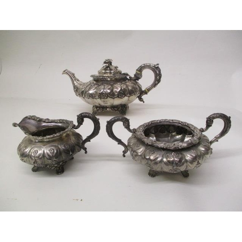 13 - A near three piece George IV Irish silver tea set by Smith & Gamble, Dublin 1830, of lobed form with...