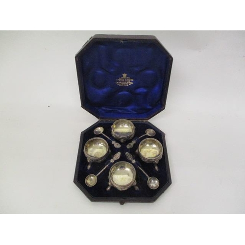 17 - A set of Victorian silver salts by Arthur Sibley, London 1874 of bulbous form embossed and chased wi...