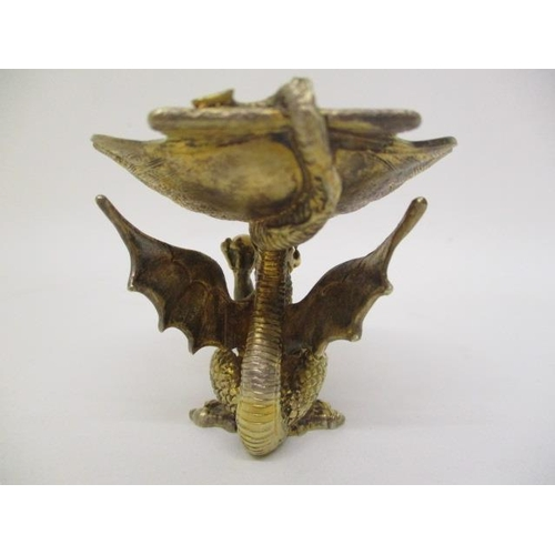 2 - A 1980s silver gilt dish by Hector Morris, London 1982, fashioned as a shell, elevated by a dragon, ...