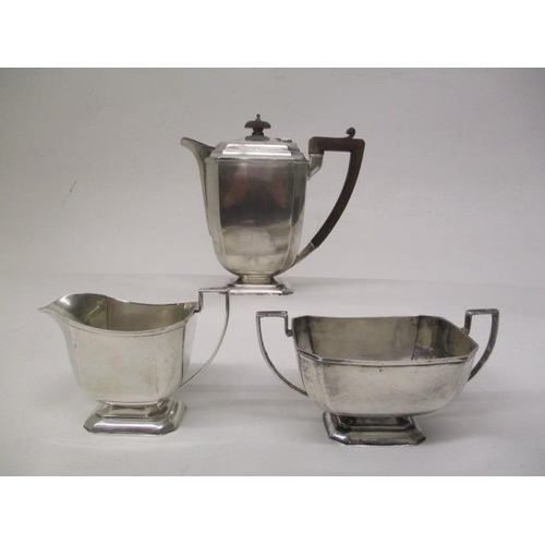 21 - A 1930s silver three piece teaset by Henry Clifford Davies, Birmingham 1931 of square, tapered form ...