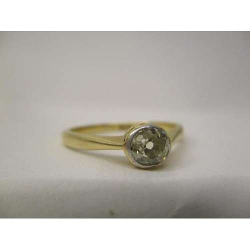 29 - A gold coloured and platinum solitaire diamond ring, approximately 0.4ct, stamped 18ct plat, size P/...
