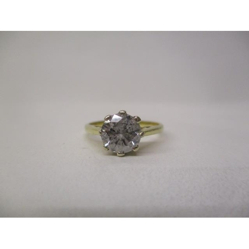 30 - A gold coloured solitaire diamond ring, approximately 1.2ct, marks rubbed, size M, 2.9g...