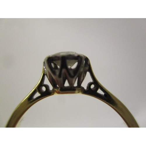 31 - A gold and platinum coloured solitaire diamond ring, approximately 0.3ct stamped 18c B & S, size L/M...