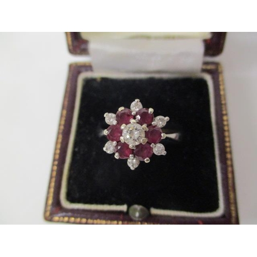 36 - An 18ct white gold diamond and ruby ring in claw setting, size P, 5g...