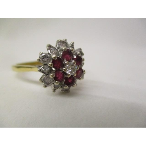 41 - An 18ct gold, diamond and ruby cluster ring set with thirteen diamonds and six rubies, stamped SAJ, ...