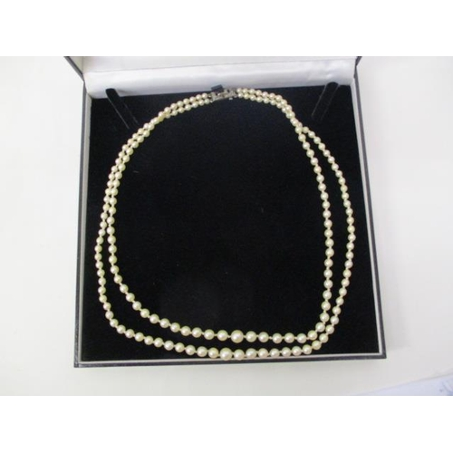 43 - A double row cultured pearl necklace with a silver marcasite Art Deco style clasp, 20