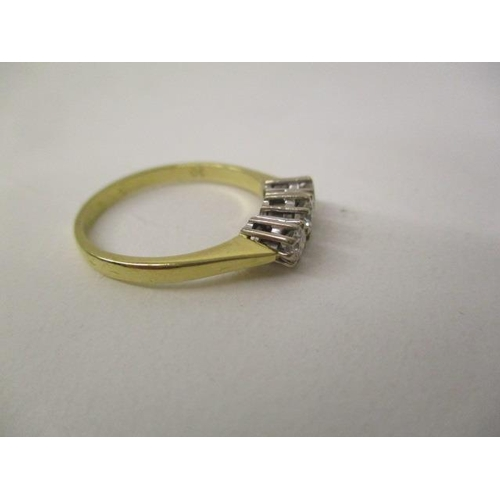 44 - An 18ct gold ring set with three diamonds, approximately 0.7ct total, size Q, 2.8g...