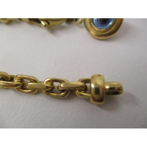 46 - An Adler gold coloured metal, chain link bracelet set with a blue and black glass bead pendant, 7 1/...