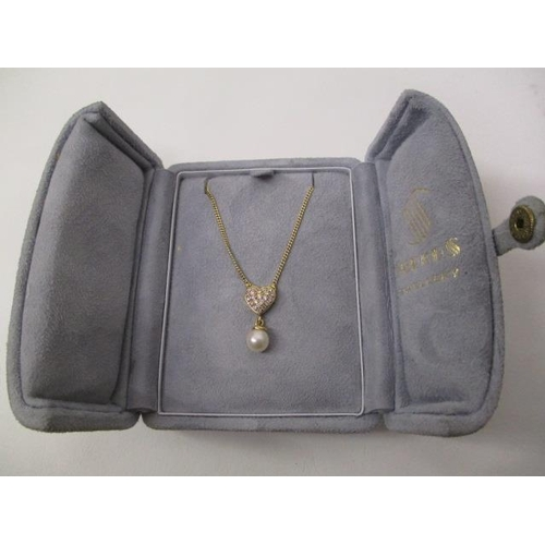 47 - A gold coloured metal necklace with heart shaped pendant, set with diamonds and a pearl on a fine ch...