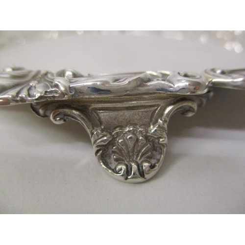 7 - A 1920s silver waiter by Williams Ltd Birmingham 1924 with a lobed and leaf border on three feet, 6 ...