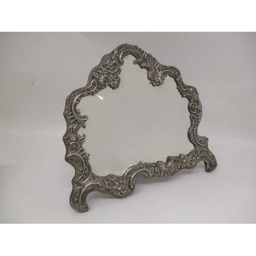 8 - An Edwardian silver and blue velvet mirror, possibly by W C London 1902 with a bevelled plate, with ...