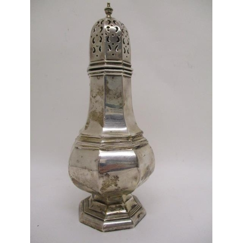 9 - An early 20th century silver octagonal sugar caster by Walker & Hall, Sheffield 1915, with a pierced...