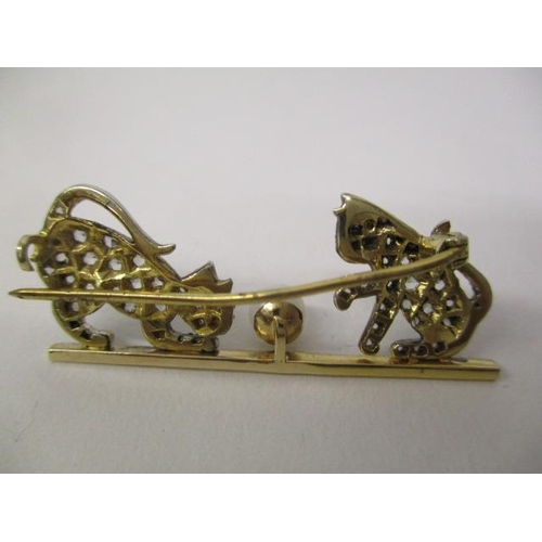 37 - A gold and white coloured metal brooch fashioned as two kittens playing with a pearl, set with sapph...