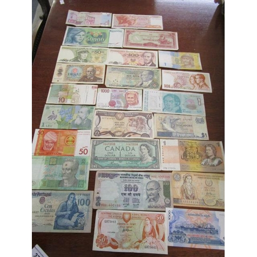 A mixed lot of banknotes from around the world to include