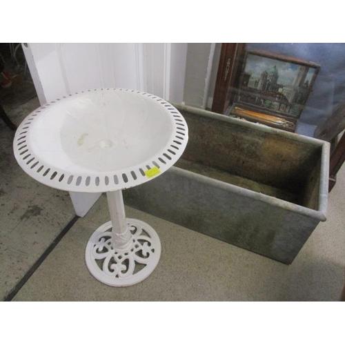 10 - A galvanized trough 16