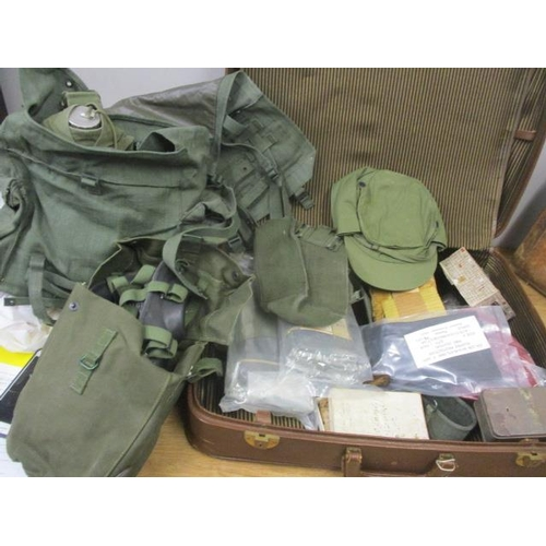 12 - 1960s British Army related items to include a water bottle, gloves, emergency food, gas mask, a 1940...