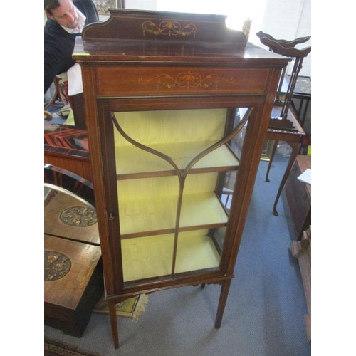 27 - An early 20th century mahogany and painted display cabinet, on square, tapering legs...