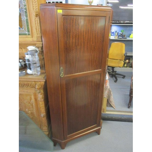 28 - A mid 20th century mahogany corner cabinet with a full eight panelled door...