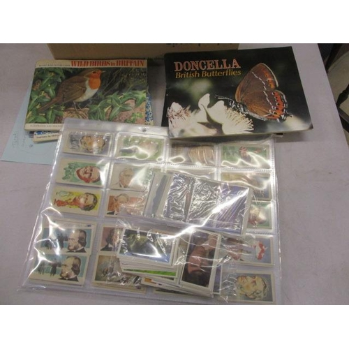 34 - A collection of mixed cigarette cards in albums and loose...