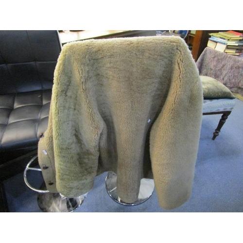 46 - An Australian 3/4 length sheep skin coat with a yellow silk lining...