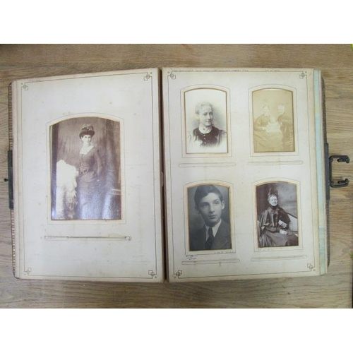 48 - A Victorian leather bound photograph album containing various family member photographs...