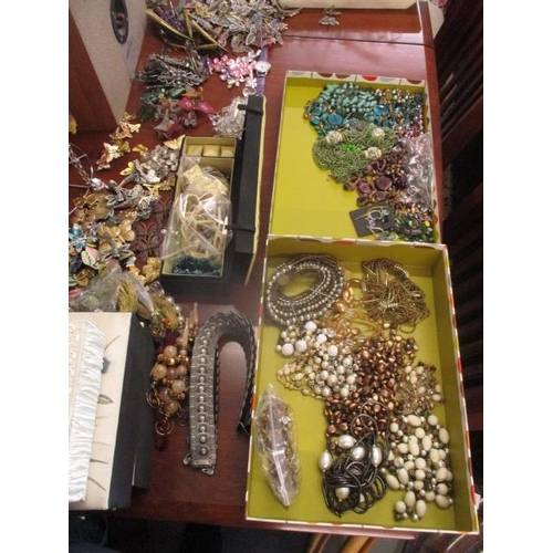 41 - A selection of costume jewellery to include necklaces, brooches, watches, jewellery boxes and stands...
