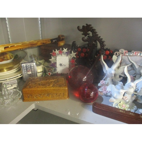 43 - A mixed lot to include paperweights, walking sticks and a cigarette case...