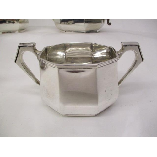 15 - A 1930s four-piece silver tea set by Mappin & Webb Birmingham 1930 of octagonal tapered form with an...