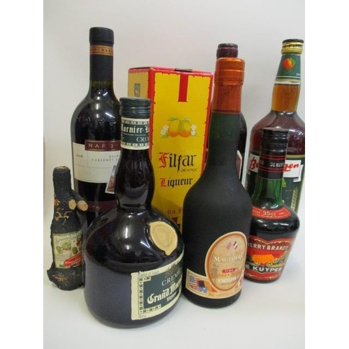 14 - Eight mixed bottles to include Calvados and Grand Marnier...