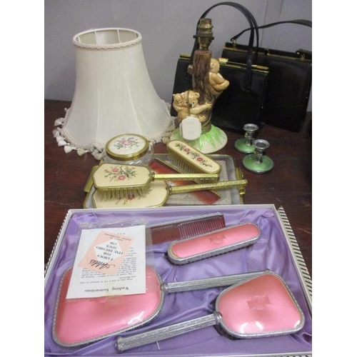 2 - A mixed lot to include two handbags, a Koala table lamp, two dressing table sets and other items...