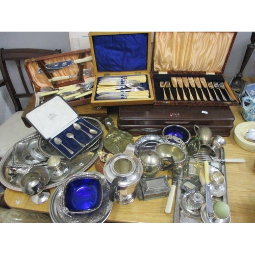 24 - A mixed lot of mainly silver plated items to include a canteen of cutlery, a coffee pot, a twin hand...
