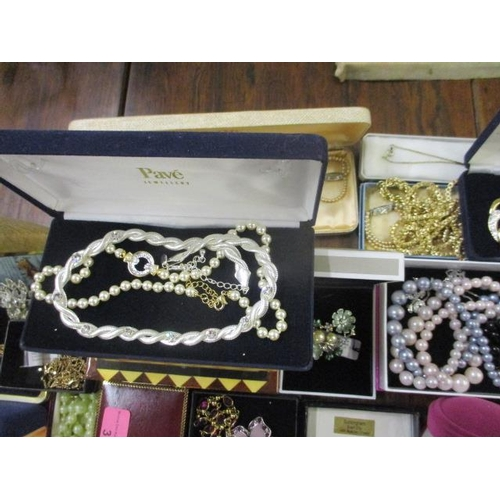 3 - A large collection of costume jewellery to include boxed brooches, necklaces, earrings, faux pearl n...