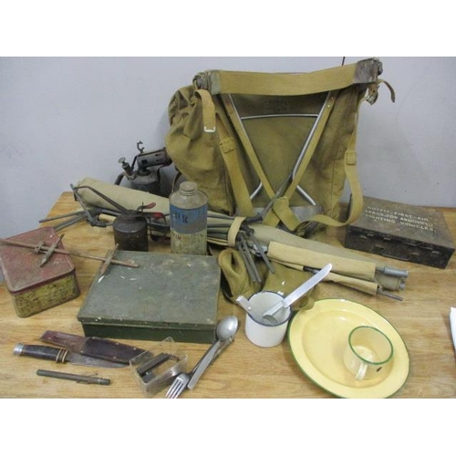 32 - Military camping equipment to include a canvas rucksack, a bed, a Milbro Kampa knife and other items...
